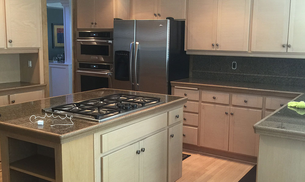 white kitchen with old dated cabinets