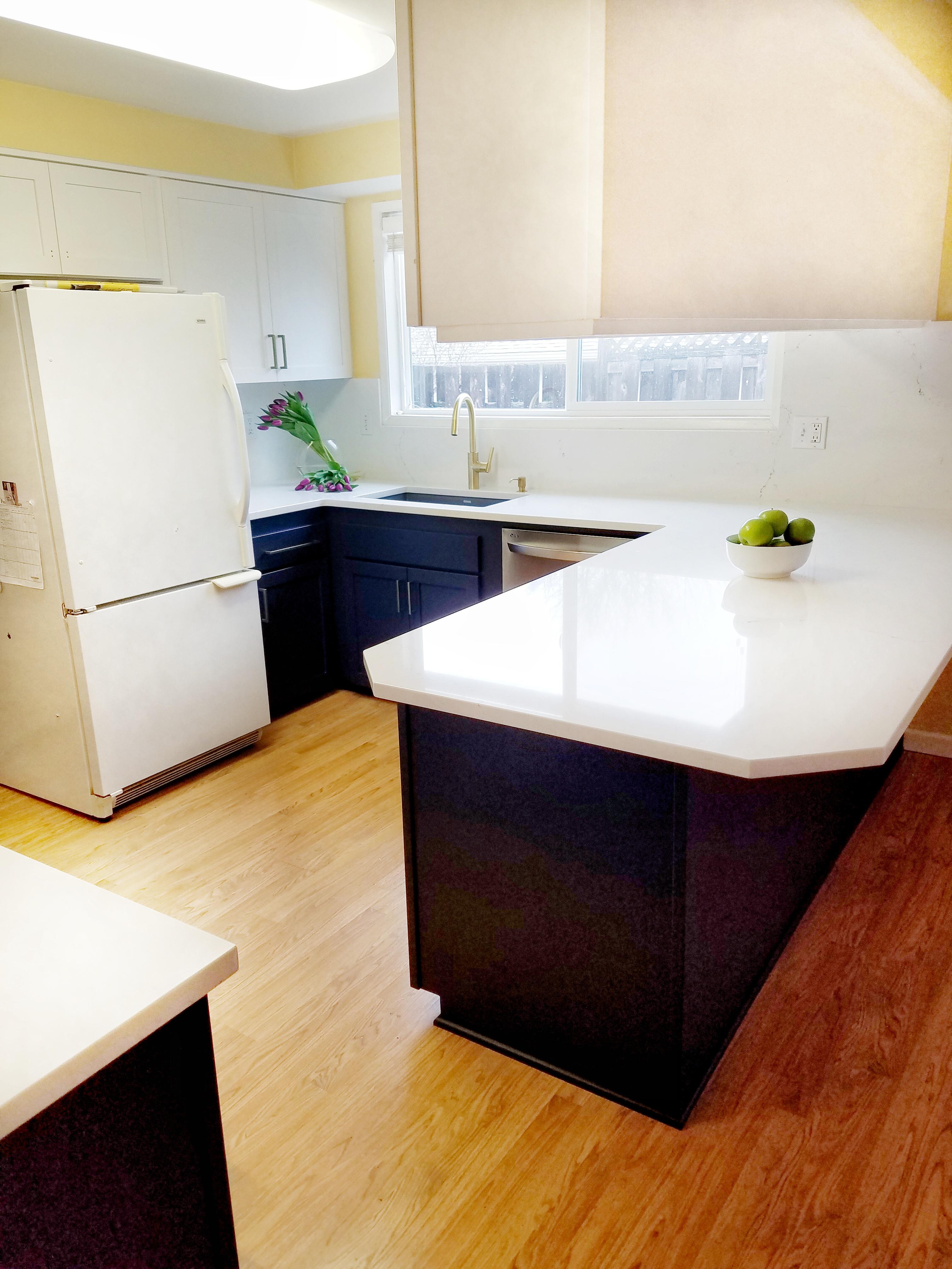 new kitchen, dark lower, white upper cabinets