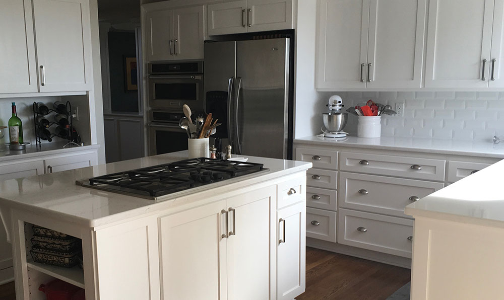 white kitchen after with shaker cabinets