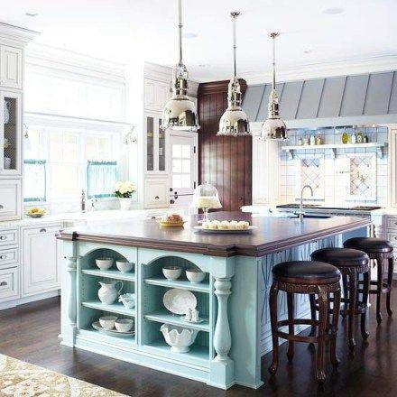 large open kitchen with blue island portland cabinet cures