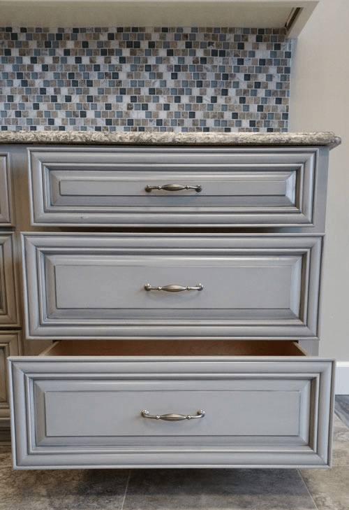 accented wire pulls on grey drawers portland cabinet cures