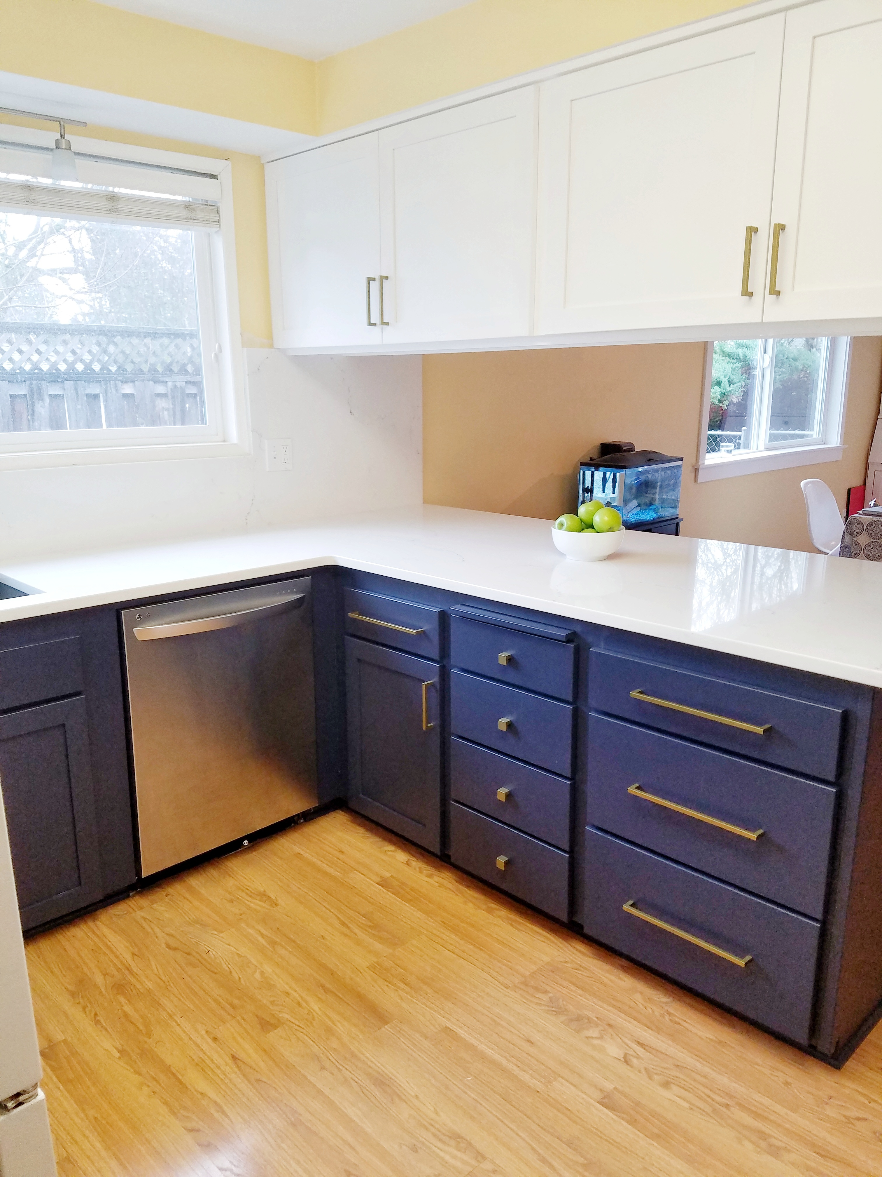 Dark lower, white upper cabinets, new counter