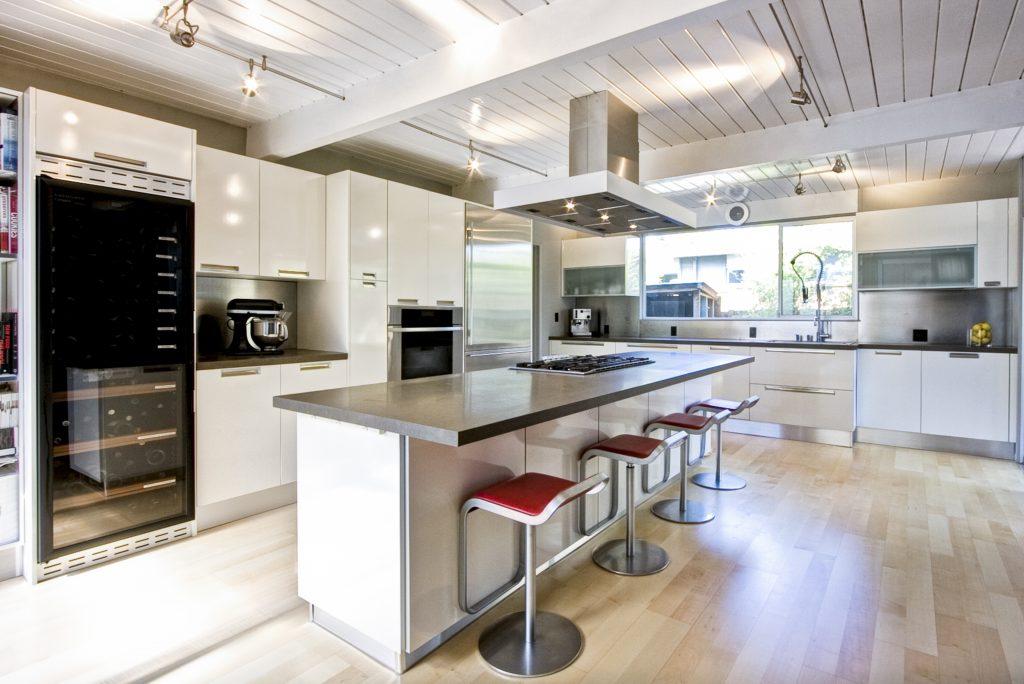 Slab, white cabinet doors really modernize a kitchen