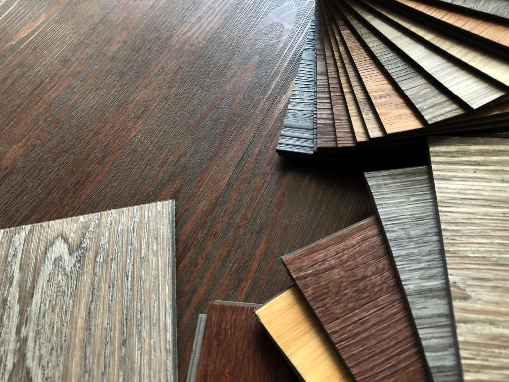 Several color samples of LVT (Luxury Vinyl Tile)