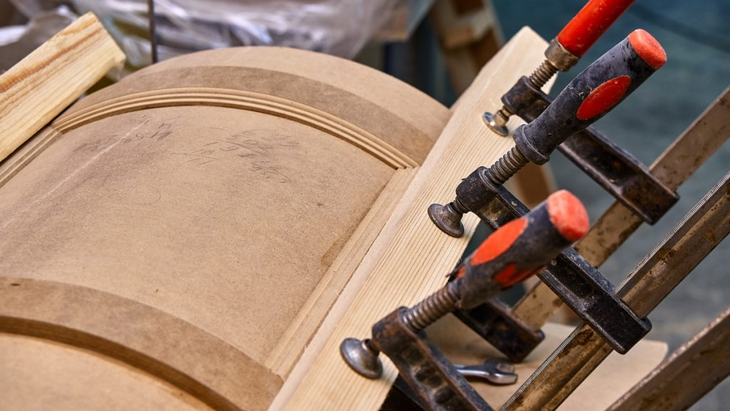 A curved MDF door being built in a shop