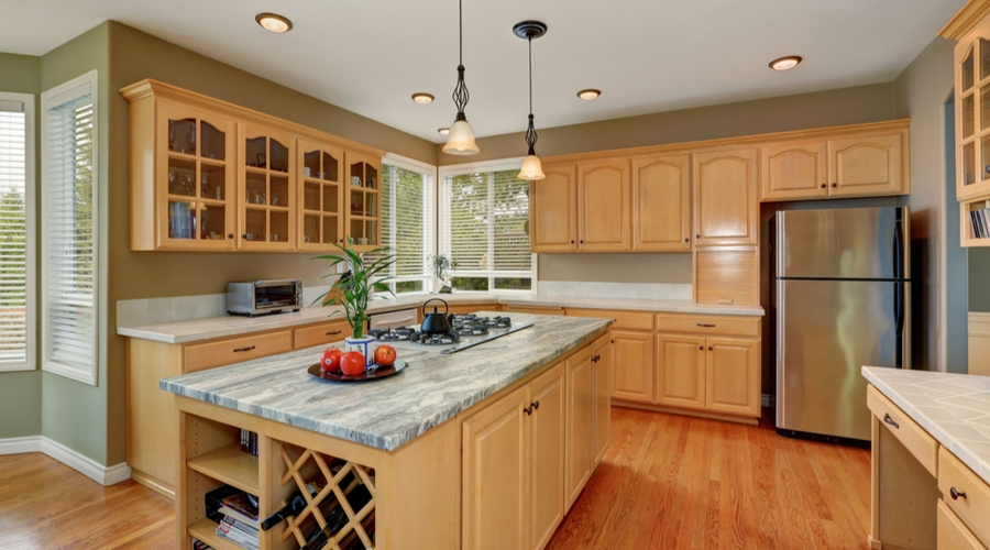 An example of a kitchen with maple wood cabinets