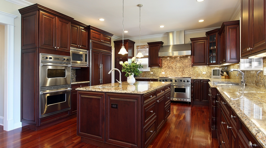 A beautifully stained kitchen with decorative end panels