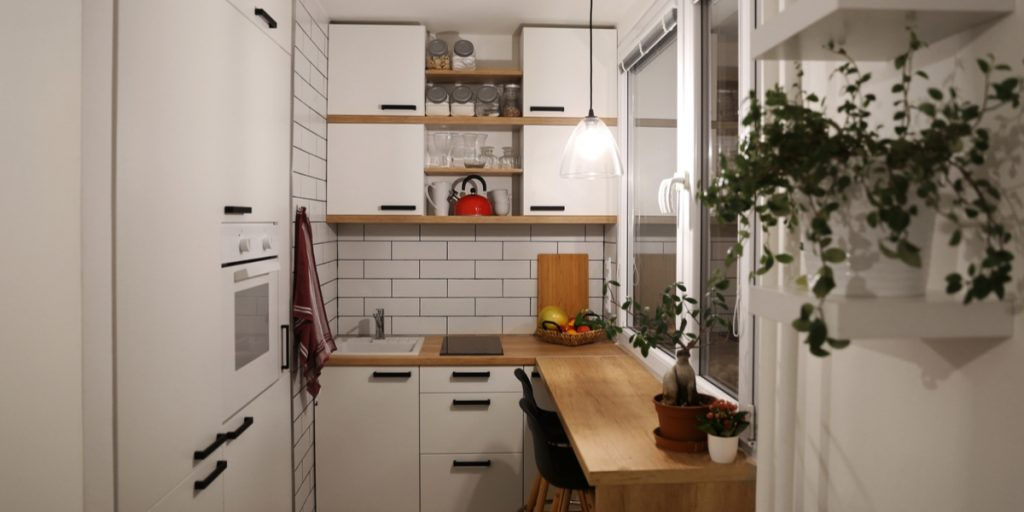 A small kitchen with open shelving