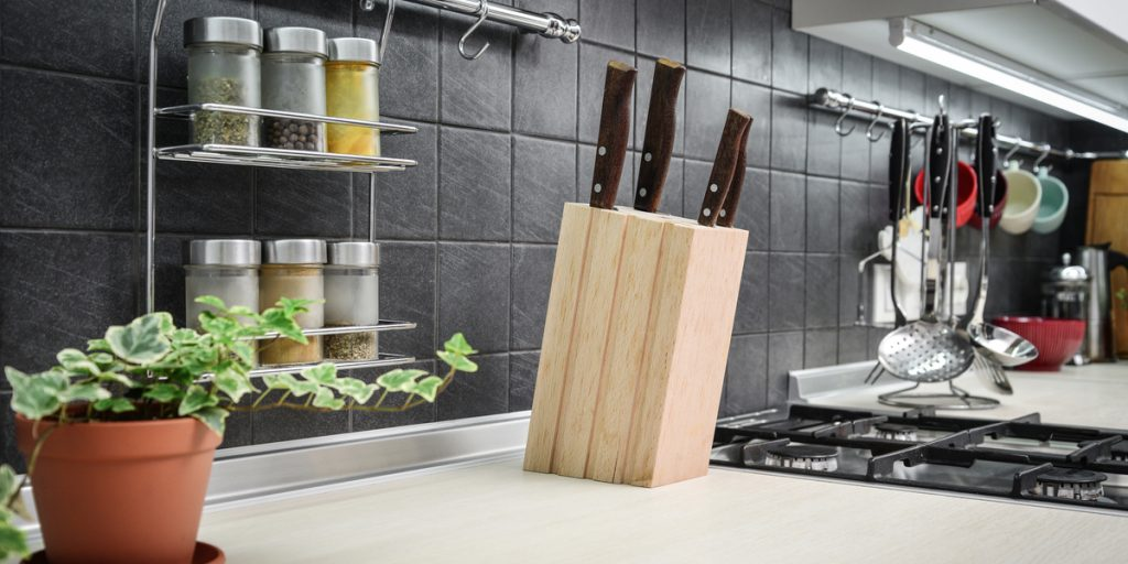 Keep a small kitchen organized with hanging spice and utensil racks