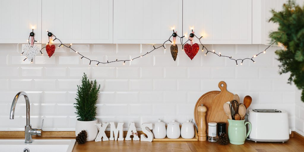 Lights strung up around the kitchen cabinets. Decorating for the holidays can be fun and simple!